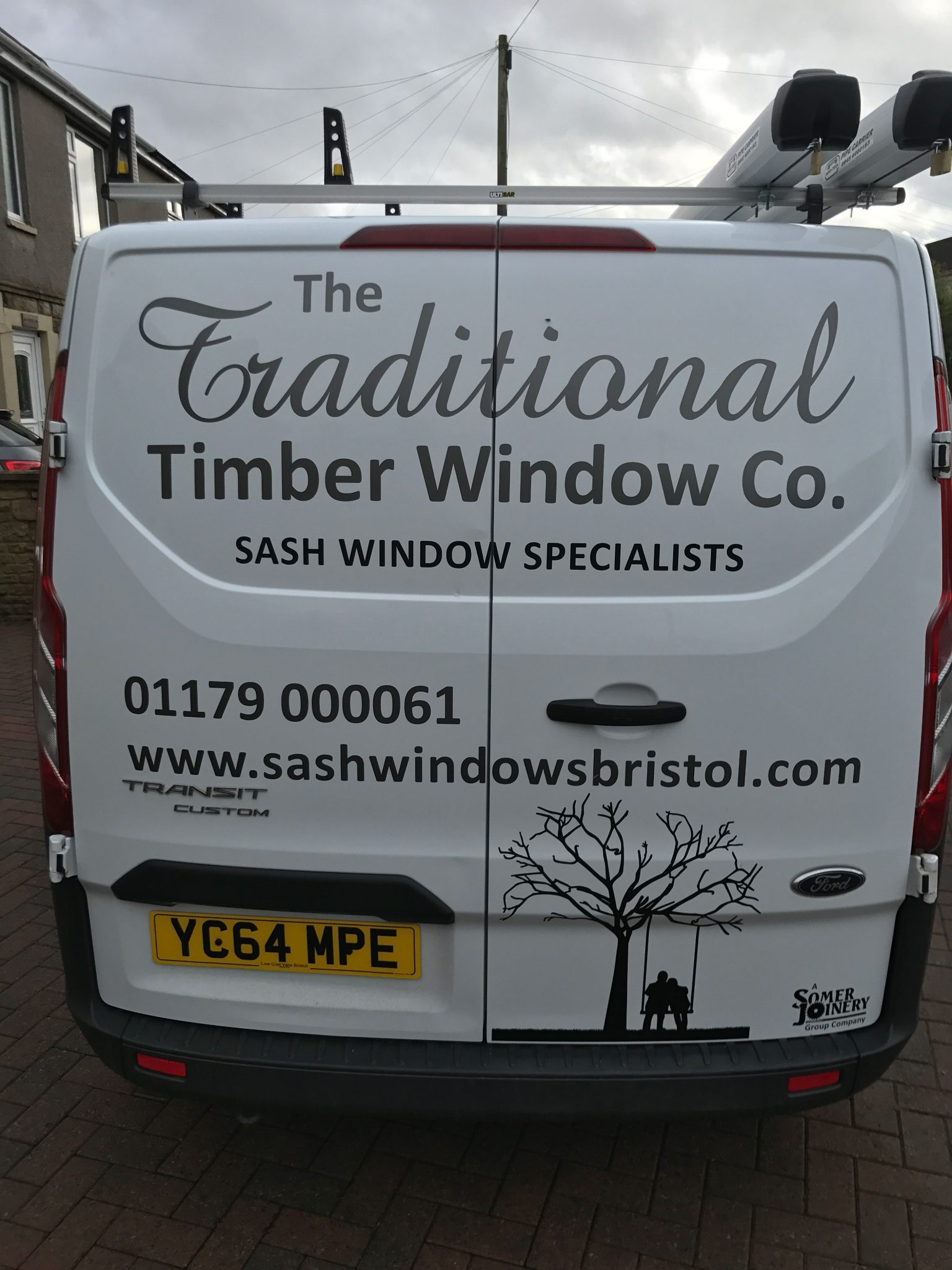 image of a traditional timber window company van